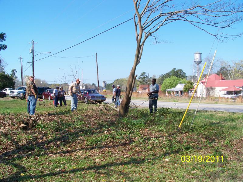Volunteers from Martin Marietta help Railroad Days clear overgrown areas surroun